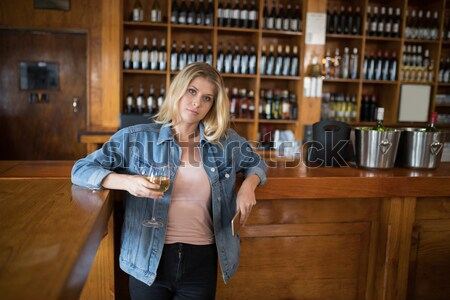Two female friends toasting glass of beer at counter Stock photo © wavebreak_media