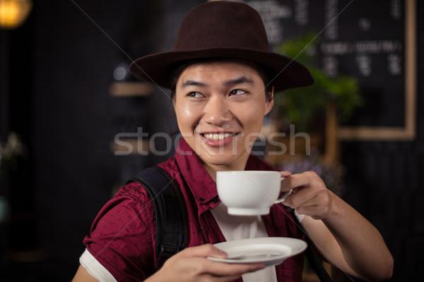 Happy customer drinking coffee Stock photo © wavebreak_media