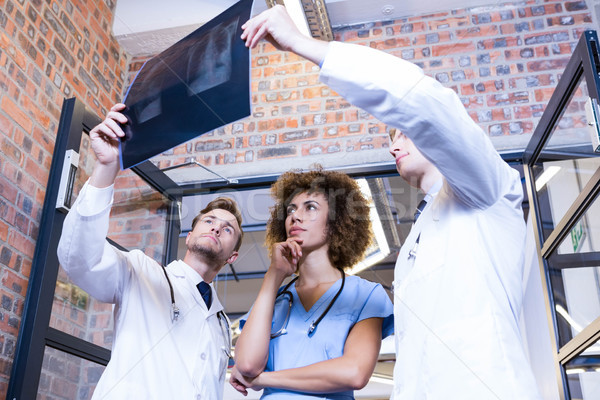 Group of doctors examining a x report Stock photo © wavebreak_media