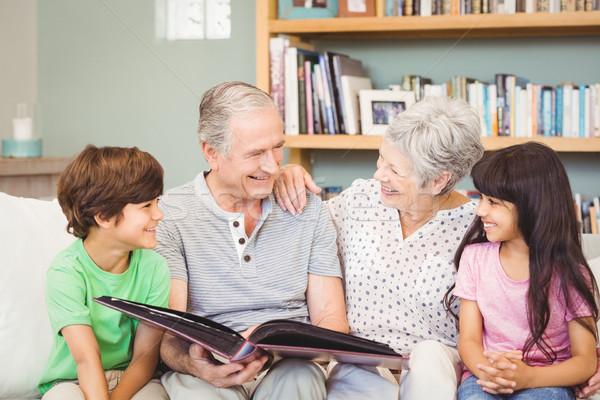 Nagyszülők mutat album unokák otthon nő Stock fotó © wavebreak_media