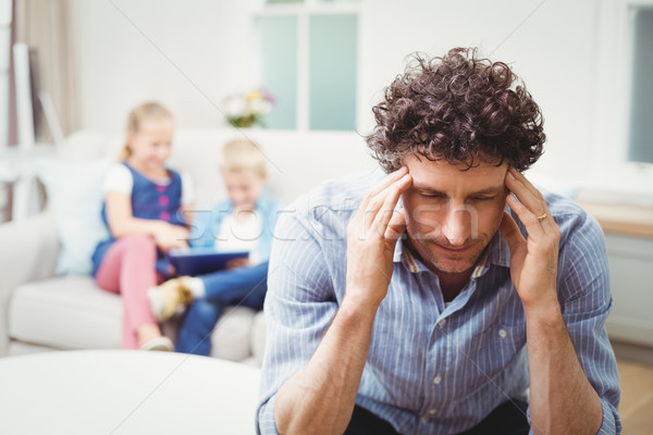 Close-up of tensed man while children in background Stock photo © wavebreak_media