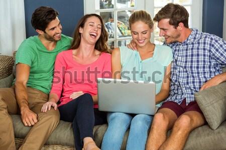 Boldog fiatal barátok ül kanapé otthon Stock fotó © wavebreak_media