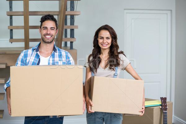 Derűs pár dobozok otthon nő ház Stock fotó © wavebreak_media