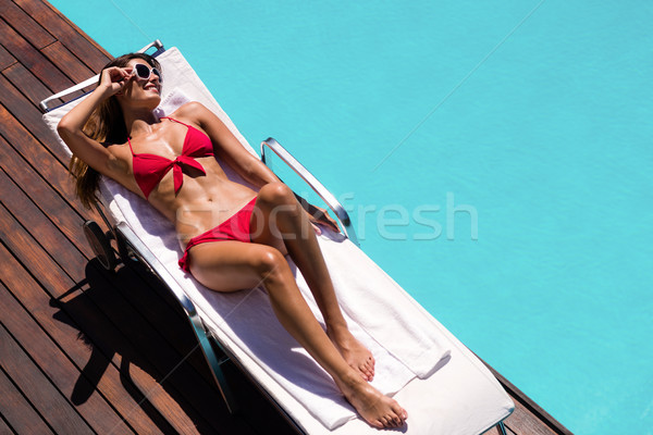 Woman enjoying sunbath on the pool edge Stock photo © wavebreak_media