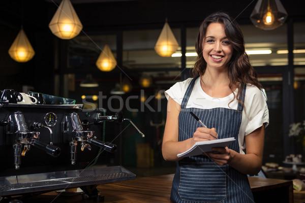 かなり バリスタ メモを取る コーヒーショップ 女性 ストックフォト © wavebreak_media