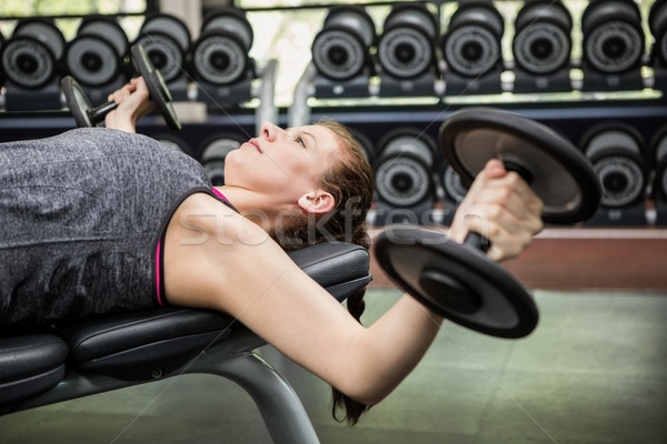 Woman working out with dumbbells Stock photo © wavebreak_media