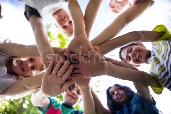 Gyerekek kezek együtt park boldog jókedv Stock fotó © wavebreak_media