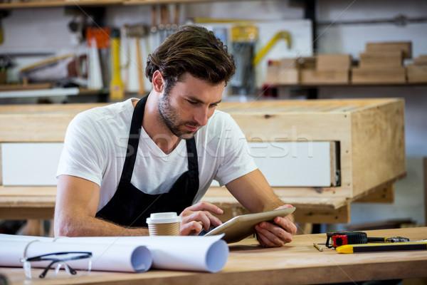 Carpenter is using his tablet Stock photo © wavebreak_media