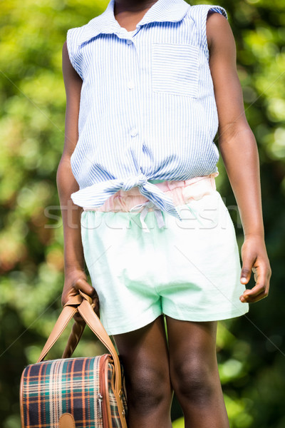 Close up of mixed-race girl holding a suitcase Stock photo © wavebreak_media