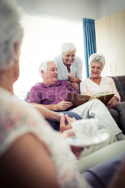 Seniors looking at pictures Stock photo © wavebreak_media