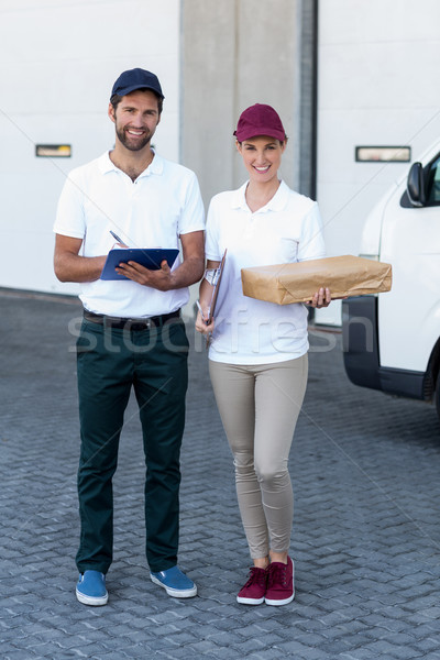 Delivery people are posing and holding goods  Stock photo © wavebreak_media