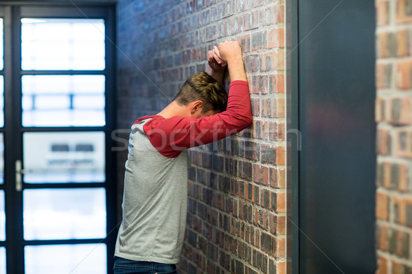 Side view of stressed man leaning on wall Stock photo © wavebreak_media