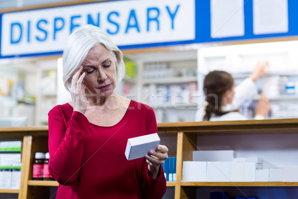 Tensed customer checking a pill box Stock photo © wavebreak_media