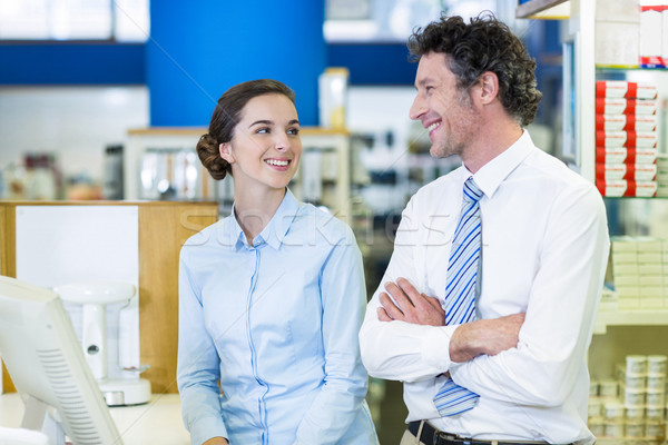 Pharmacists interacting with each other in pharmacy Stock photo © wavebreak_media