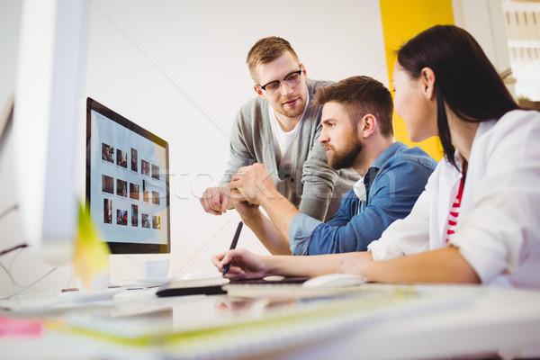 Executive assisting colleagues at creative office Stock photo © wavebreak_media