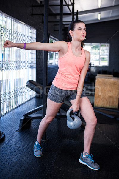 Young woman lifting kettlebell in gym Stock photo © wavebreak_media