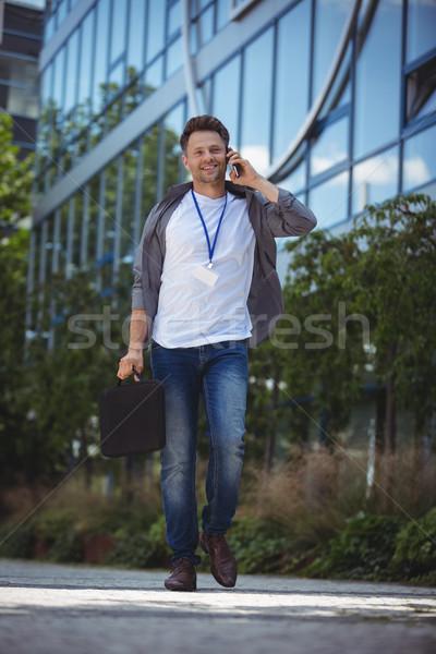 Handsome business executive talking on mobile phone Stock photo © wavebreak_media