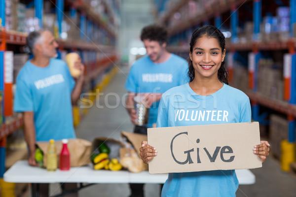 Portrait of happy volunteer holding sign boards with message  Stock photo © wavebreak_media