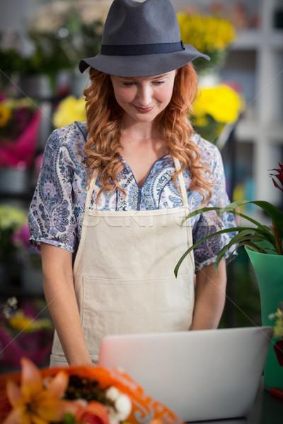 Florist using laptop in flower shop Stock photo © wavebreak_media