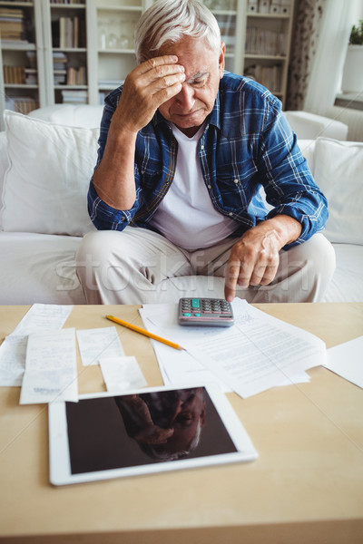 Tensed senior man checking the bills Stock photo © wavebreak_media
