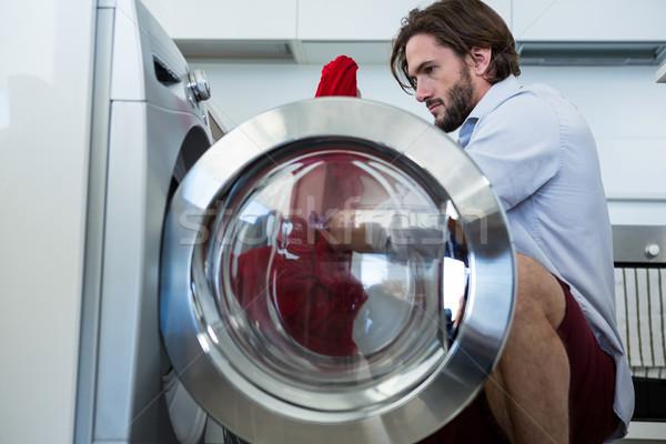 Uomo vestiti lavatrice home casa cucina Foto d'archivio © wavebreak_media