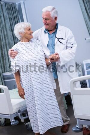 Doctor adjusting a glucose bottle Stock photo © wavebreak_media