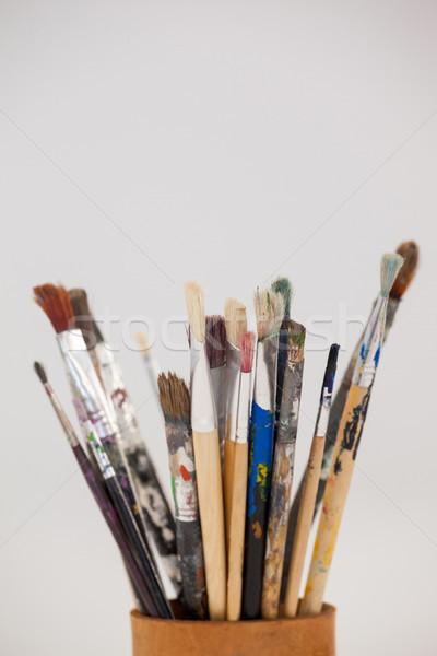 Varieties of paint brushes in jar Stock photo © wavebreak_media