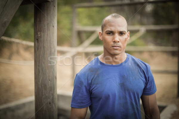 Portrait of determined man standing during obstacle course Stock photo © wavebreak_media