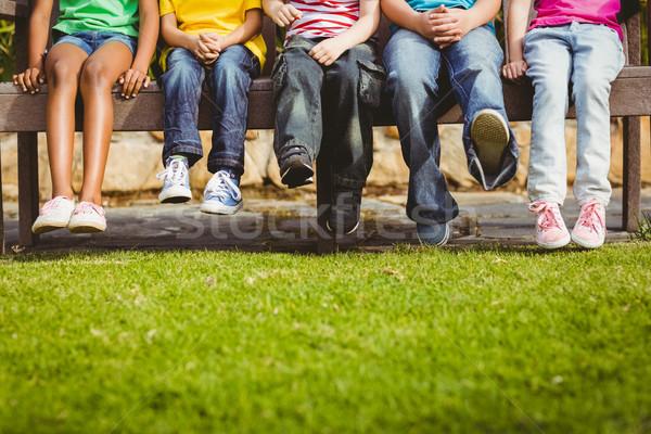 Close up view of classmates sitting on bench Stock photo © wavebreak_media