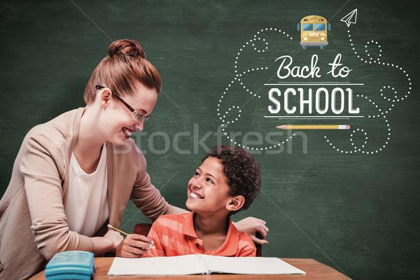 Composite image of teacher helping pupil Stock photo © wavebreak_media