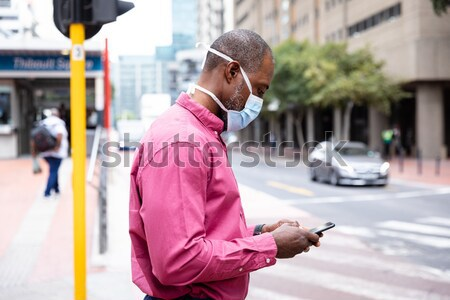 Smiling woman in the city with breast cancer awareness Stock photo © wavebreak_media