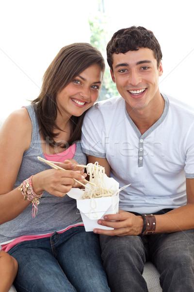 Sorridere Coppia adolescenti mangiare pasta home Foto d'archivio © wavebreak_media