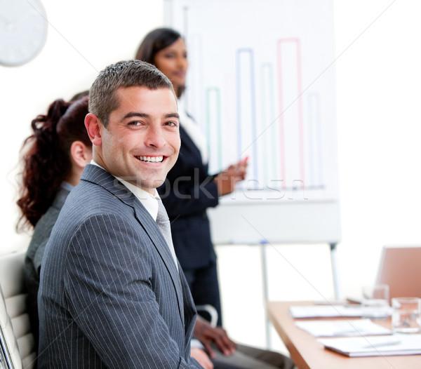 小さな ビジネスマン プレゼンテーション チーム 作業 ルーム ストックフォト © wavebreak_media