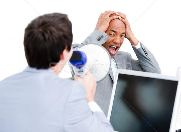 Caucasian businessman yelling through a megaphone Stock photo © wavebreak_media