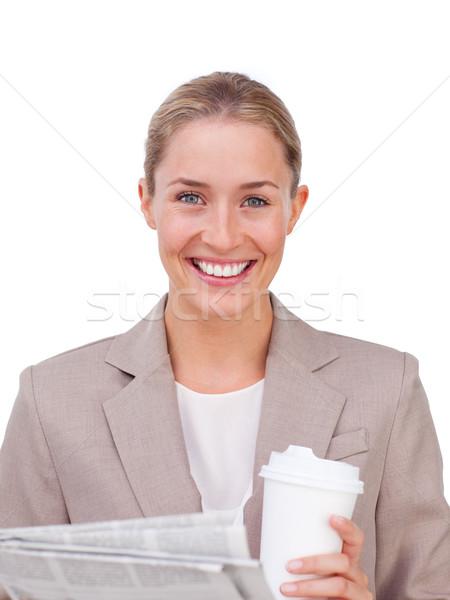 Charyzmatyczny kobieta interesu pitnej kawy czytania gazety Zdjęcia stock © wavebreak_media