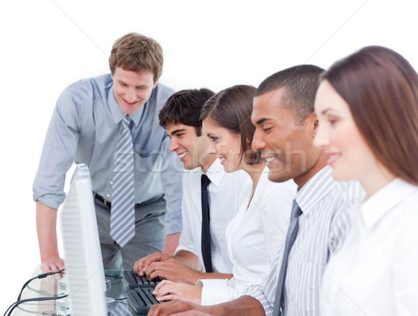 Competitivo equipo de negocios de trabajo ordenador oficina hombre Foto stock © wavebreak_media