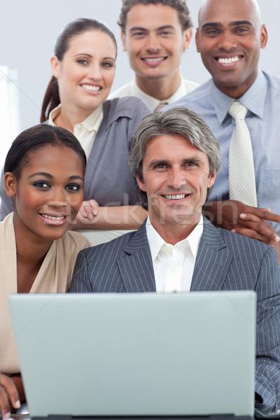 Diverso equipe de negócios trabalhando laptop reunião computador Foto stock © wavebreak_media