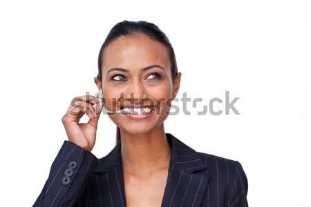 Smiling Indian businesswoman talking on a headset Stock photo © wavebreak_media