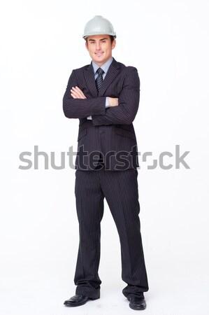 Pie atractivo empresario doblado armas blanco Foto stock © wavebreak_media