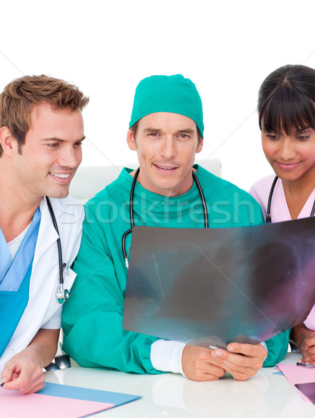 Ambitious medical team looking at X-ray Stock photo © wavebreak_media