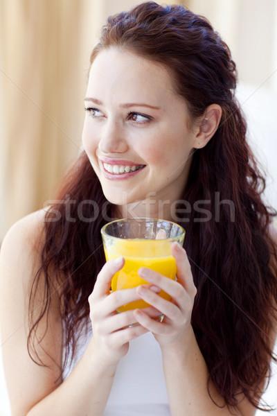 Portrait of woman drinking orange juice in bedroom Stock photo © wavebreak_media