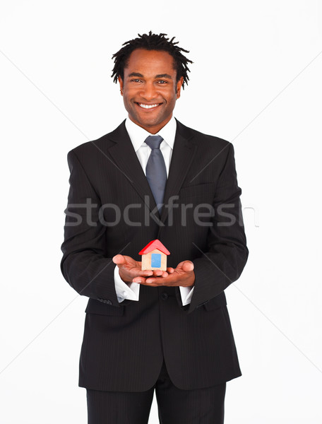 Afro-american businessman presenting housing solution  Stock photo © wavebreak_media