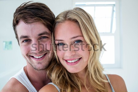 Delighted couple relaxing in each others Company Stock photo © wavebreak_media