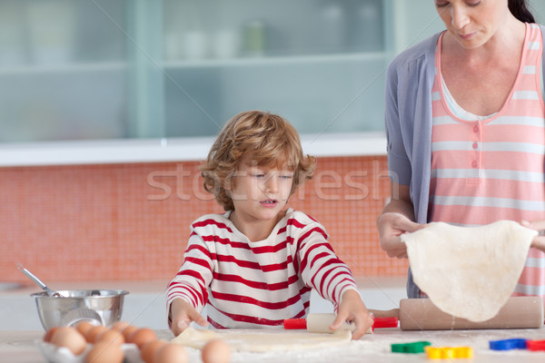Cheerful mother and her son baking in a kitchen Stock photo © wavebreak_media