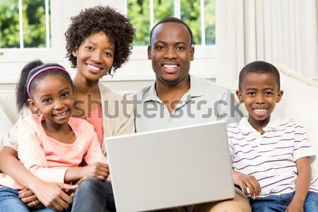 счастливым молодые семьи используя ноутбук Жилье компьютер Сток-фото © wavebreak_media