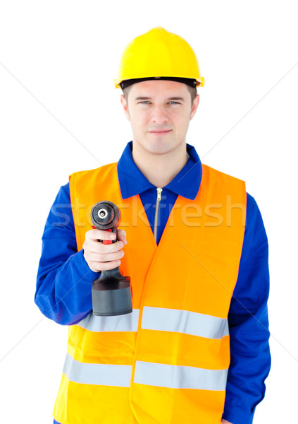 Young male worker wearing helmet and holding boring machine against white background  Stock photo © wavebreak_media