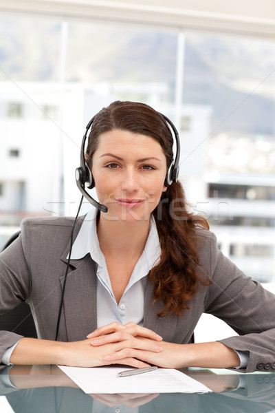 Portrait of a charismatic businesswoman with earpiece sitting in an office Stock photo © wavebreak_media