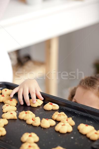 Meisje cookie keuken ouders Stockfoto © wavebreak_media