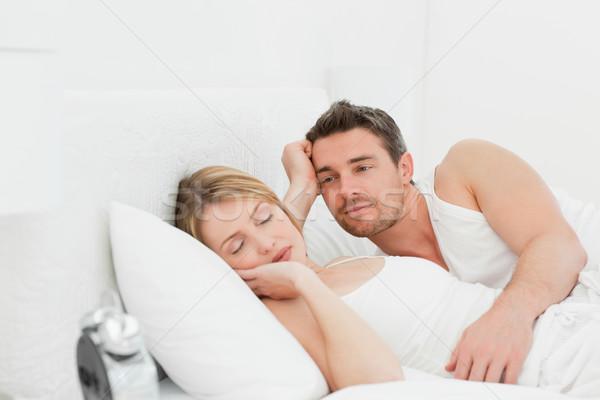 Boyfriend looking at his girlfriend who is  sleeping Stock photo © wavebreak_media