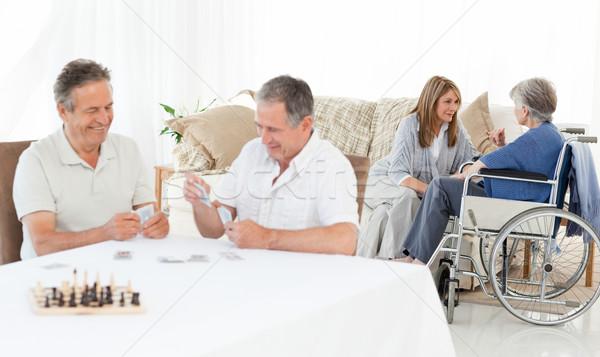 Férfiak kártyapakli beszél férfi boldog szív Stock fotó © wavebreak_media